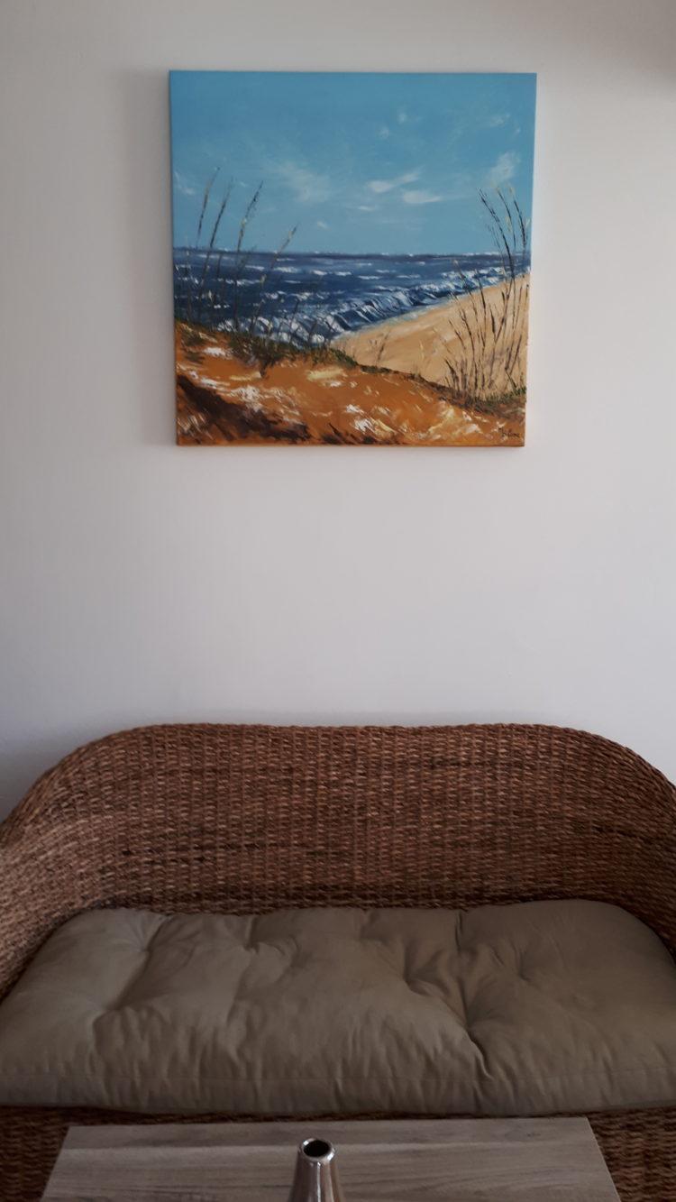 A la mer un jour de vent, tableau peint à l'huile et au couteau, accroché au mur de mon salon. Toile carrée de 80cm de cotés